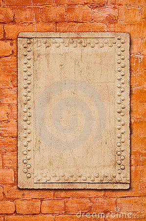 Metal plate on brick wall