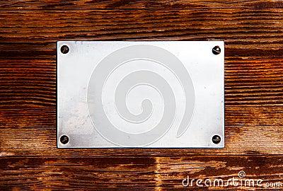 Metal plate on a wood