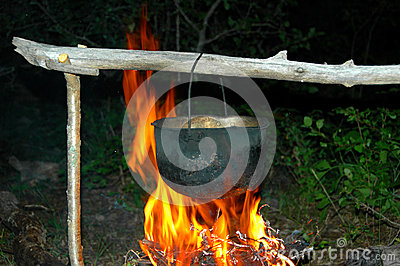 Metal pot under a fire