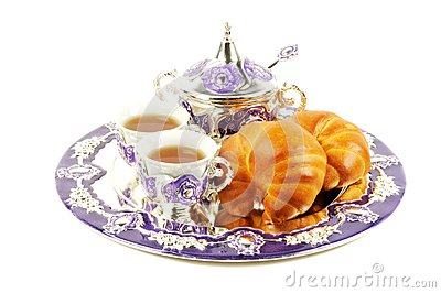 Metal set for tea and croissant