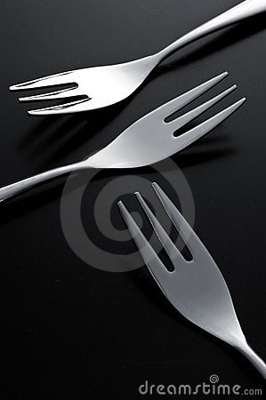 The metal shiny fork on black background