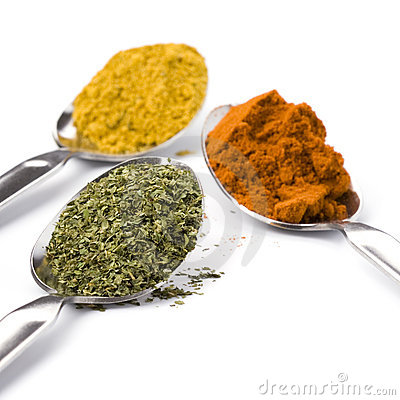 Metal spoons with spices