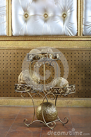 Metal stand with golden balls decorative element