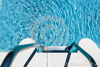 Metal steps into inviting blue pool