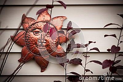 Metal Sun Ornament on Wall