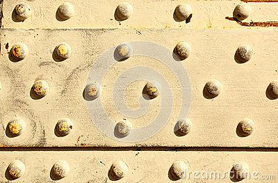 Metal surface with rivets