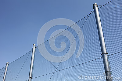 Metal wire fence with blue sky