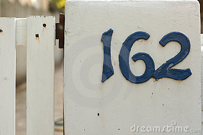 Metallic blue house numbers on white picke
