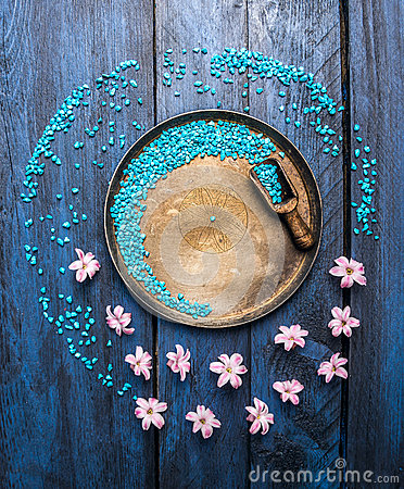 Free Metallic Bowl With Sea Salt, Scoop And Flowers On Blue Wooden Table, Wellness Background, Top View Royalty Free Stock Images - 51111699