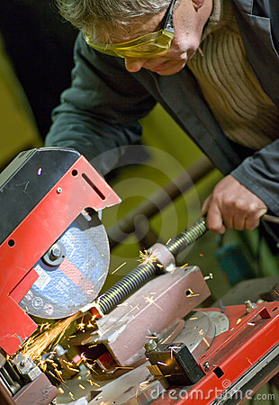 Metalworker cutting metal