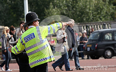 Metropolitan police officer giving directions Editorial Image