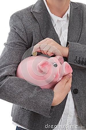 Metta la moneta nel porcellino salvadanaio
