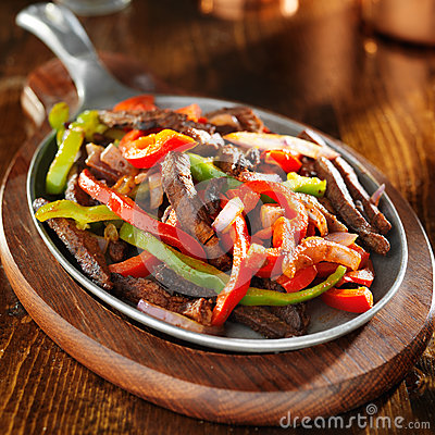 Free Mexican Food - Beef Fajitas And Bell Peppers Royalty Free Stock Photos - 43366628