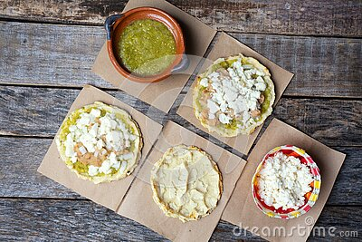 Mexican food: sopes with green sauce and beans. Mexican food: sopes with green sauce, fresh cheese and beans stock photos
