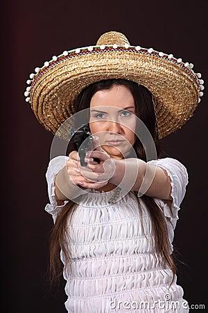 Mexican girl hold revolver