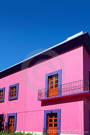Mexican pink house facade  wooden doors