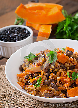 Free Mexican Vegan Vegetable Pilaf With Haricot Beans And Pumpkin Stock Photo - 58654570