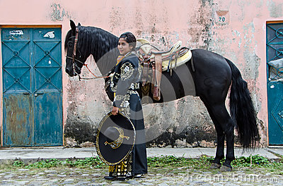 Mexican woman and black horse