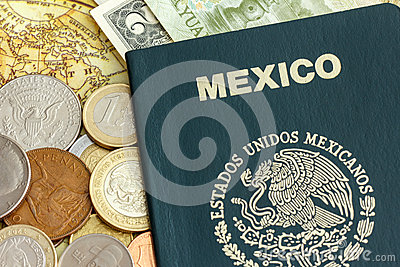 Mexico passport with world currency over a map