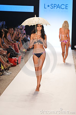 MIAMI - JULY 14: Model walks runway at the L Space Swimsuit Collection for Spring/ Summer 2012 Editorial Photography