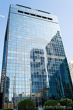Free Miami, USA - October 30, 2015: Skyscraper Building With Glass Facade On Blue Sky. Architecture And Design. Commercial Property Or Royalty Free Stock Photo - 115035565