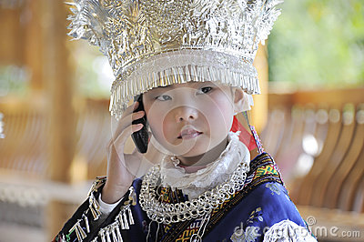 Miao nationality little girl with mobile phone Editorial Image