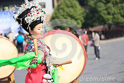 Miao nationality woman beat a drum Editorial Photography