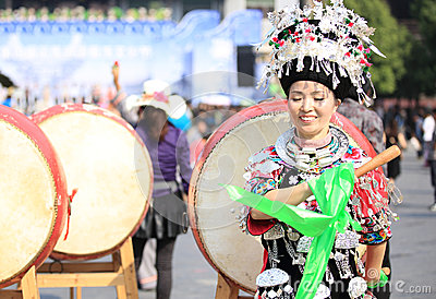 Miao nationality woman beat a drum Editorial Stock Photo
