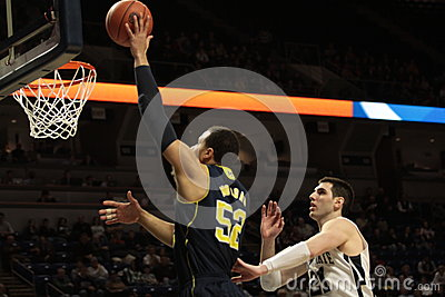 Michigan forward Jordan Morgan dunks the basketball Editorial Photography
