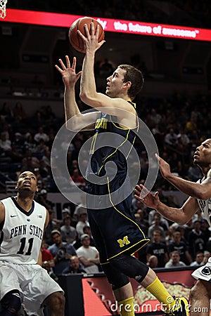 Michigan guard Nik Stauskas. goes up for a shot Editorial Image
