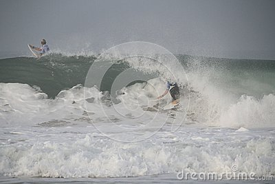 Mick Fanning tube riding a wave Editorial Stock Image