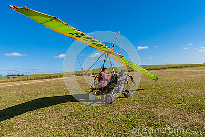 Microlight Aircraft Pilot Refueling  Editorial Stock Image