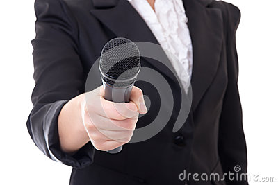 Microphone in female reporter s hand over white
