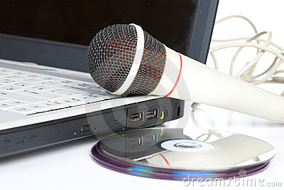 The microphone lays on notebook