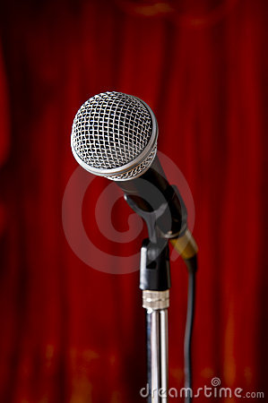 Microphone on Red Stage Curtain Background
