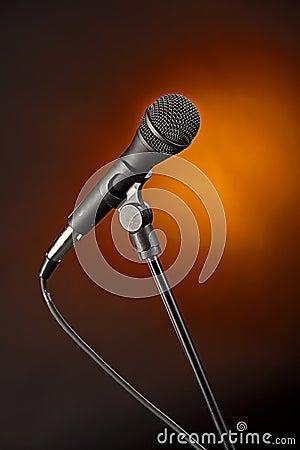 Microphone on Spotlight Gold Backgorund