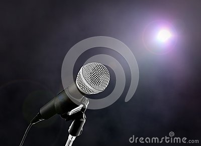 Microphone on Stage under Spotlight