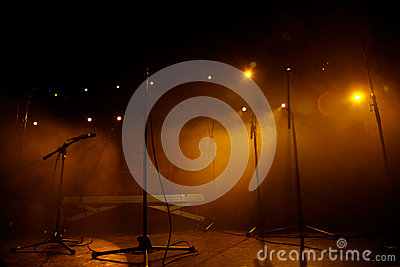 Microphones in an empty rock concert stage