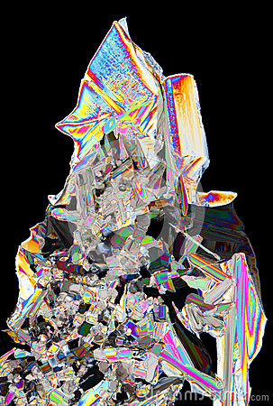Microscopic view of potassium nitrate crystals in polarized ligh
