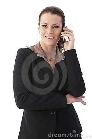 Mid adult businesswoman with cellphone