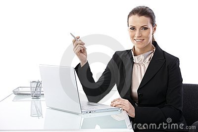 Mid-adult elegant businesswoman at desk