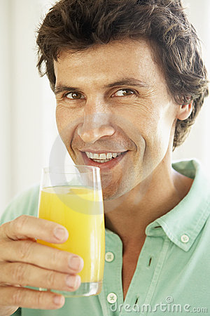 Mid Adult Man Drinking A Glass Of Orange Juice