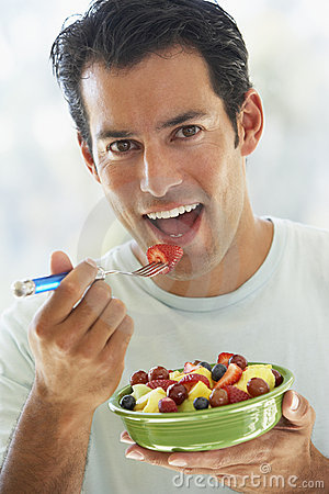 Mid Adult Man Eating Fresh Fruit Salad