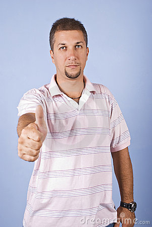 Mid adult man giving thumbs up