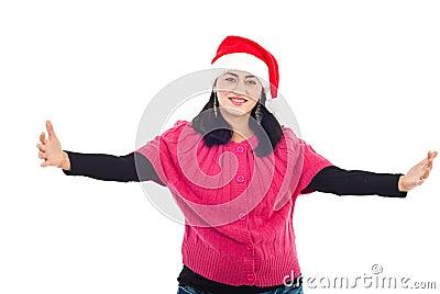 Mid adult Santa helper woman with open hands