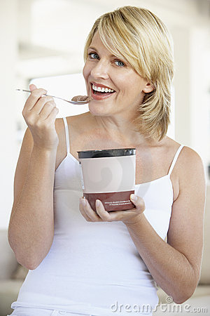 Mid Adult Woman Eating Chocolate Ice-Cream