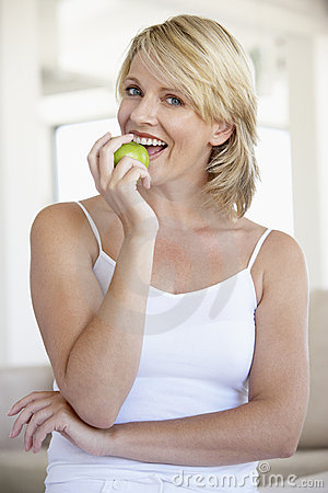 Mid Adult Woman Eating Green Apple