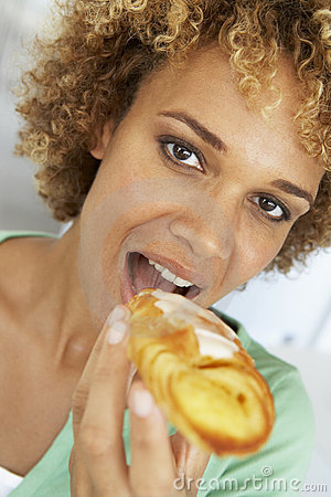 Mid Adult Woman Eating A Pastry