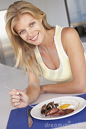 Free Mid Adult Woman Eating Unhealthy Breakfast Royalty Free Stock Images - 7872039