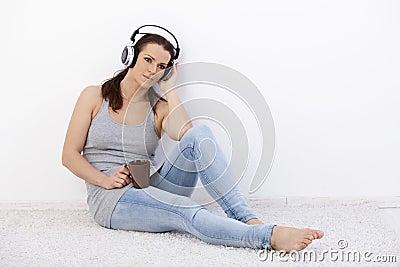Mid-adult woman enjoying music